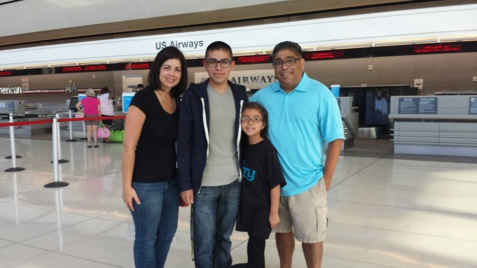 Samaniego family poses with Andrew prior to him leaving for Naval Academy Prep School